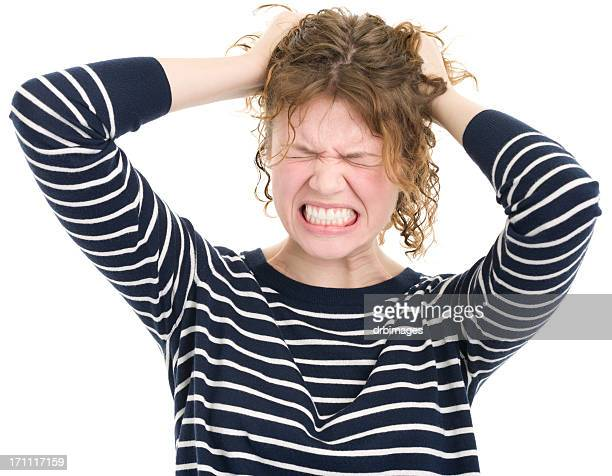 Furious Young Woman Tearing Out Hair