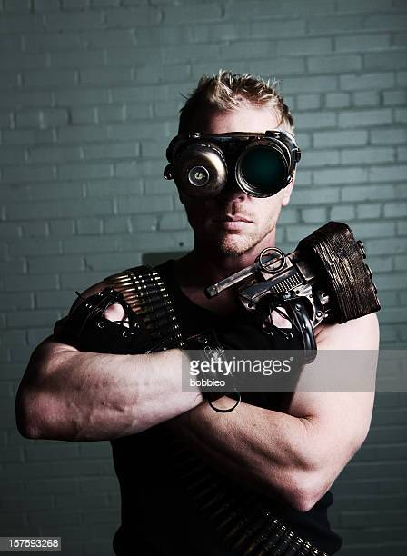 Furistic male with cyborg goggles and weapon