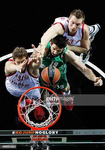 Furkan Aldemir, #19 of Darussafaka Dogus Istanbul competes with Patrick Heckmann, #33 of Brose Baskets Bamberg and Leon Radosevic, #43 of Brose...