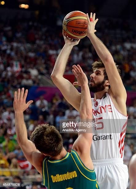 Furkan Aldemir of Turkey vies with Matthew Dellavedova of Australia during the 2014 FIBA Basketball World Cup basketball match between Turkey and...