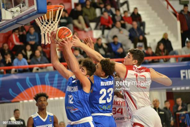 Furkan Haltali of Turkey vies Isaiah Stone Rivera and Giancarlo Bastianoni Sanchez of Dominican Republic during Fiba U17 Basketball World Cup 2018...