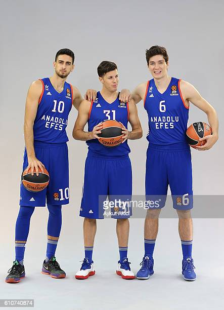 Furkan Korkmaz #10 of Anadolu Efes Istanbul Thomas Heurtel 31 and Cedi Osman #6 poses during the 2016/2017 Turkish Airlines EuroLeague Media Day at...