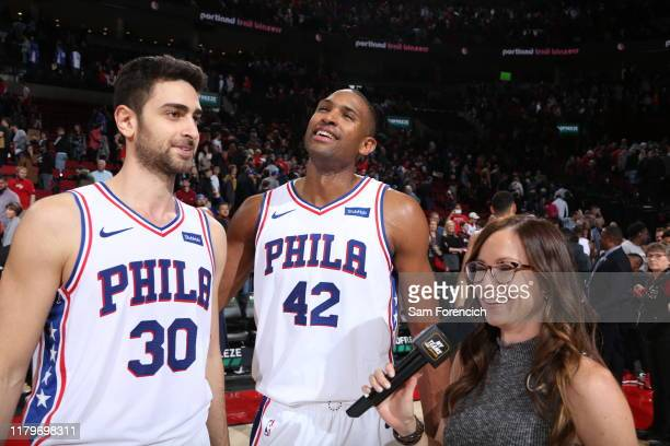 Furkan Korkmaz and Al Horford of the Philadelphia 76ers celebrate after a game against the Portland Trail Blazers on November 2 2019 at the Moda...
