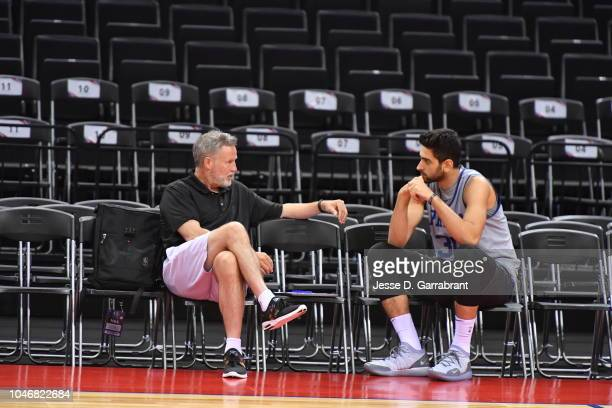 Furkan Korkmaz and Brett Brown of the Philadelphia 76ers talk during practice as part of the 2018 China Games on October 7 2018 at the Shenzhen...