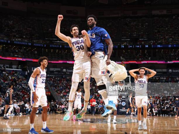 Furkan Korkmaz and Joel Embiid of the Philadelphia 76ers celebrate during the game against the New Orleans Pelicans on October 20, 2021 at the...