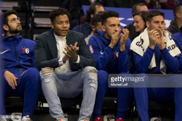 Furkan Korkmaz Markelle Fultz Landry Shamet and TJ McConnell of the Philadelphia 76ers watch the game from the bench in the first quarter against the...