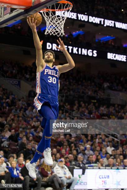 Furkan Korkmaz of the Philadelphia 76ers attempts a layup against the New Orleans Pelicans at the Wells Fargo Center on November 21 2018 in...
