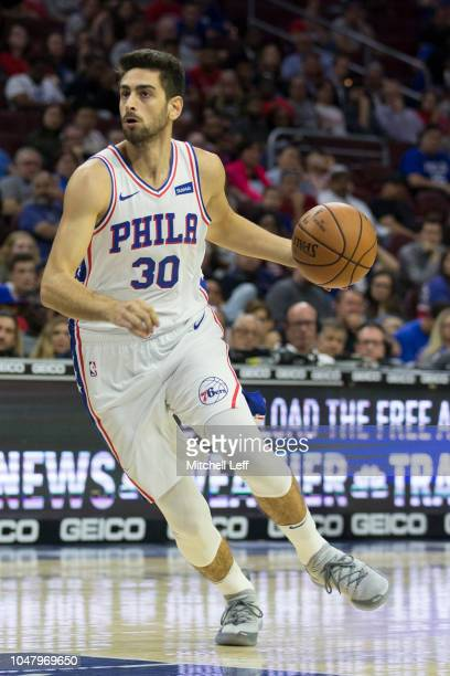 Furkan Korkmaz of the Philadelphia 76ers dribbles the ball against the Orlando Magic during the preseason game at Wells Fargo Center on October 1...