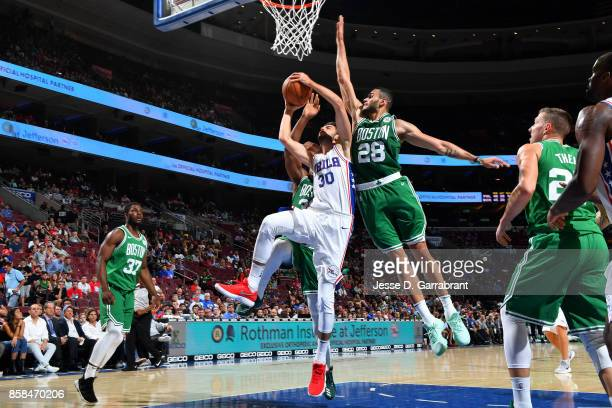 Furkan Korkmaz of the Philadelphia 76ers goes for a lay up during the game against the Boston Celtics during a preseason on October 6 2017 at Wells...