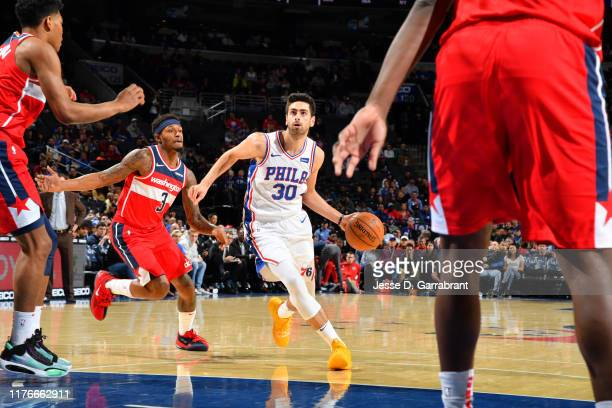 Furkan Korkmaz of the Philadelphia 76ers handles the ball against the Washington Wizards during a preseason game on October 18 2019 at the Wells...
