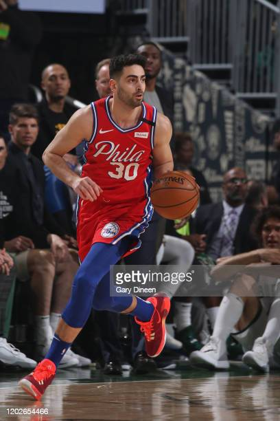 Furkan Korkmaz of the Philadelphia 76ers handles the ball against the Milwaukee Bucks on February 22 2020 at the Fiserv Forum in Milwaukee Wisconsin...