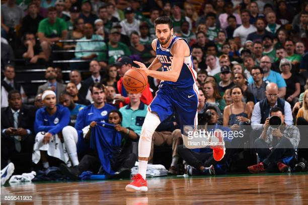 Furkan Korkmaz of the Philadelphia 76ers handles the ball against the Boston Celtics during the preseason game on October 9 2017 at the TD Garden in...