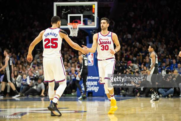 Furkan Korkmaz of the Philadelphia 76ers high fives Ben Simmons of the Philadelphia 76ers after making a threepoint shot during the first quarter of...
