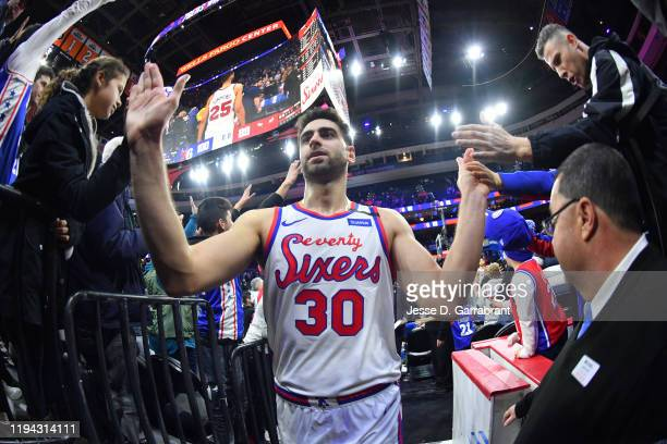 Furkan Korkmaz of the Philadelphia 76ers highfives fans after a game against the Chicago Bulls on January 17 2020 at the Wells Fargo Center in...