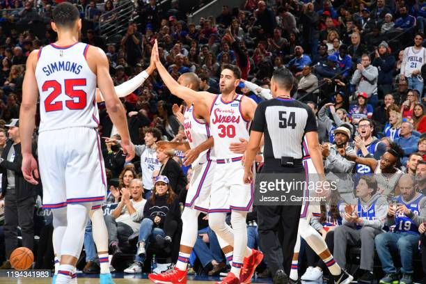 Furkan Korkmaz of the Philadelphia 76ers highfives his teammates during a game against the Chicago Bulls on January 17 2020 at the Wells Fargo Center...
