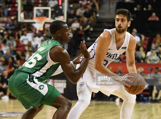 Furkan Korkmaz of the Philadelphia 76ers is guarded by Jabari Bird of the Boston Celtics during the 2018 NBA Summer League at the Thomas Mack Center...
