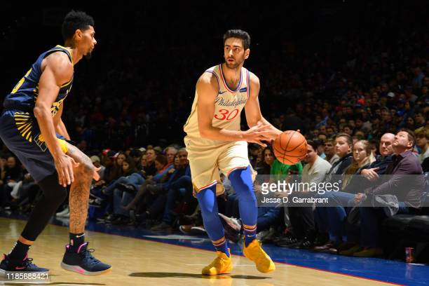 Furkan Korkmaz of the Philadelphia 76ers looks to pass the ball against the Indiana Pacers on November 30 2019 at the Wells Fargo Center in...