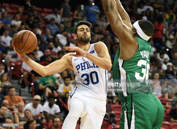 Furkan Korkmaz of the Philadelphia 76ers passes around Guerschon Yabusele of the Boston Celtics during the 2018 NBA Summer League at the Thomas Mack...