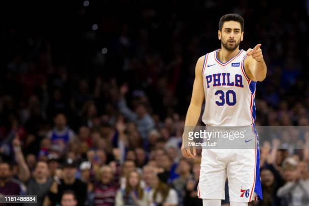 Furkan Korkmaz of the Philadelphia 76ers points against the Charlotte Hornets in the first quarter at the Wells Fargo Center on November 10 2019 in...
