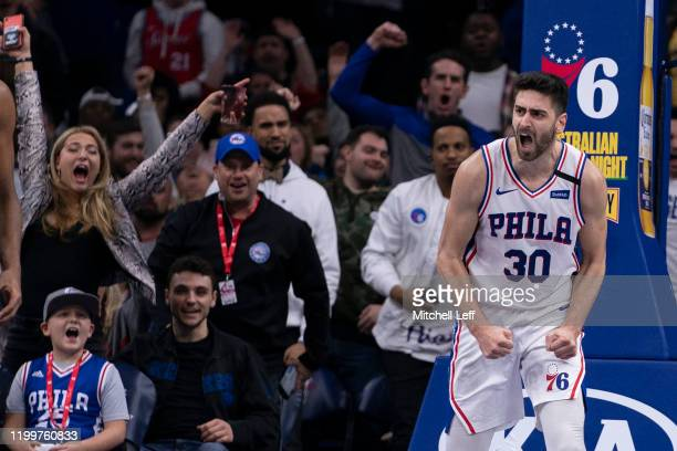 Furkan Korkmaz of the Philadelphia 76ers reacts after dunking the ball against the Chicago Bulls in the fourth quarter at the Wells Fargo Center on...