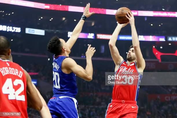 Furkan Korkmaz of the Philadelphia 76ers shoots the ball against Landry Shamet of the LA Clippers during a game at the Staples Center on March 1 2020...