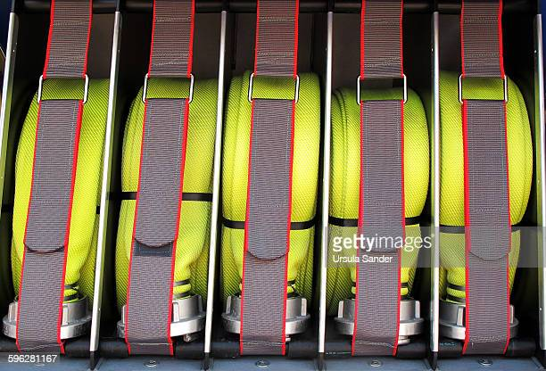 Furled fire hoses in fire engine