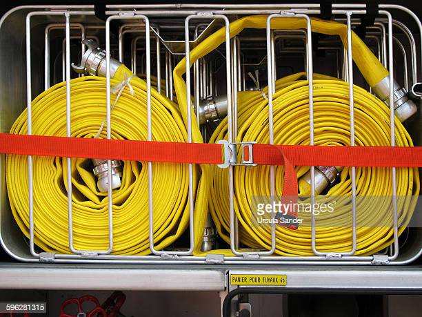 Furled fire hoses in french fire engine