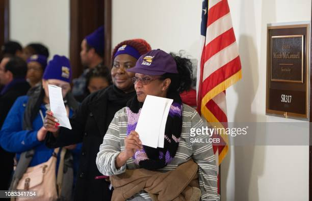 Furloughed contract workers including security officers and custodians who have not been paid during the partial government shutdown hold unpaid...