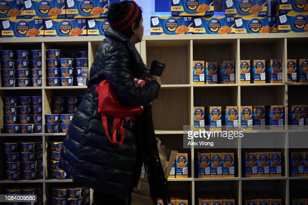 A furloughed federal worker picks free food at a popup store of Kraft Heinz January 17 2019 in Washington DC Kraft Heinz opened a store to distribute...