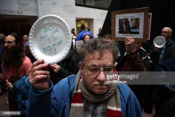 Furloughed federal workers and those aligned with them protest the partial government shutdown in the Hart Senate Office Building January 23 2019 in...