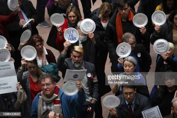 Furloughed federal workers and those aligned with them protest the partial government shutdown in the Hart Senate Office Building January 23, 2019 in...