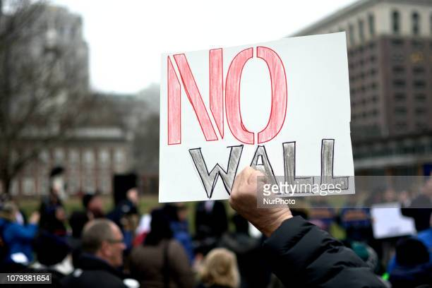 Furloughed federal workers joined by elected officials hold up sings to protest the federal government shutdown during a nonpartisan rally at...