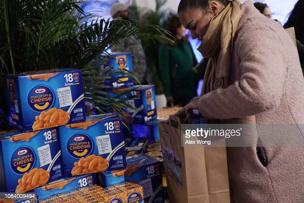Furloughed federal workers pick up free food at a popup store of Kraft Heinz January 17 2019 in Washington DC Kraft Heinz opened a store to...