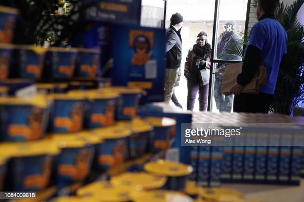 Furloughed federal workers show their IDs for entering a popup store of Kraft Heinz January 17 2019 in Washington DC Kraft Heinz opened a store to...