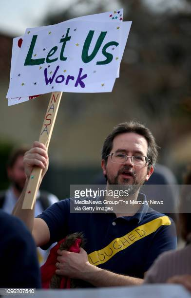 Furloughed research scientist Mark Ditzler of San Jose joins in a rally outside the NASA Ames Research Center calling for an end to the government...