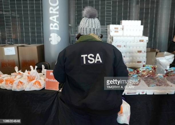 A furloughed Transportation Security Administration employee looks at food at the Barclays Center as the Food Bank For NYC holds food distribution...
