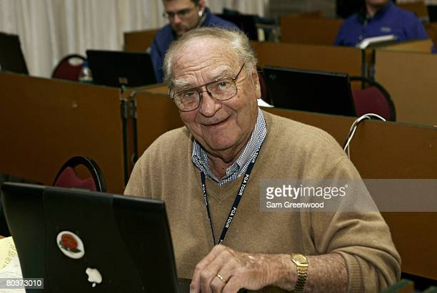 Furman Bisher of the Atlanta Journal Constitution celebrates his 88th birthday while covering the third round of the THE TOUR Championship at East...