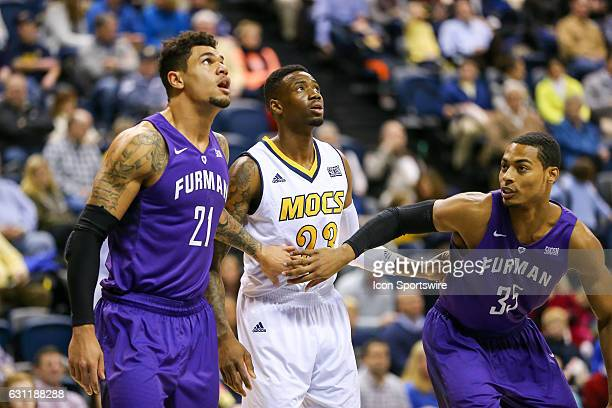 Furman Paladins forward Kris Acox and Chattanooga Mocs forward Tre' McLean look for a rebound during the first half of the NCAA basketball game...