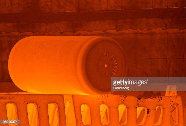A furnace heats an ingot of titanium alloy before pressing at the VSMPOAVISMA Corp plant in Verkhnyaya Salda Russia on Monday May 14 2018 The Russian...