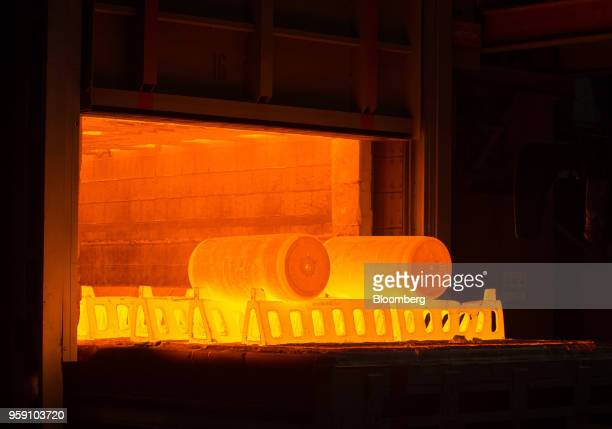 A furnace heats two ingots of titanium alloy before pressing at the VSMPOAVISMA Corp plant in Verkhnyaya Salda Russia on Monday May 14 2018 The...