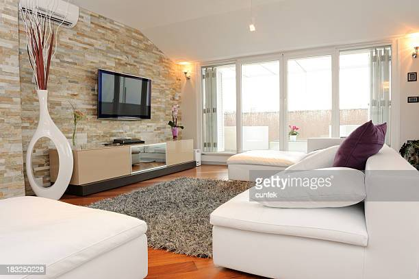 Furnished living room with view of balcony