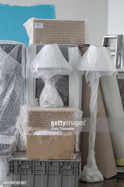 Furniture and boxes wrapped in bubble wrap