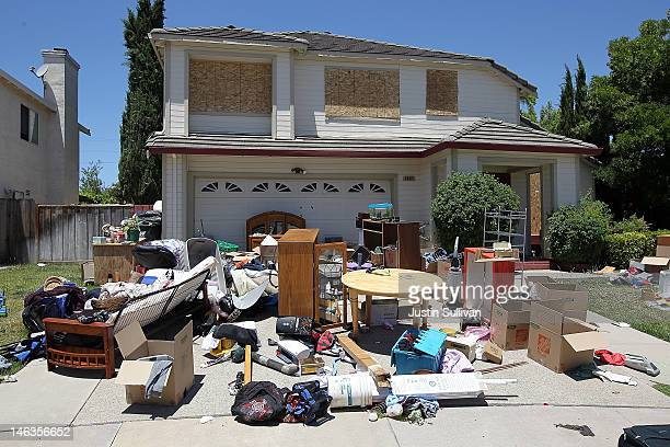 Furniture and personal belongings sit in front of a house that appears to be abandoned on June 14 2012 in Antioch California May foreclosure filings...