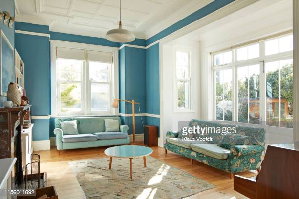 furniture arranged in living room - indoors stock pictures, royalty-free photos & images