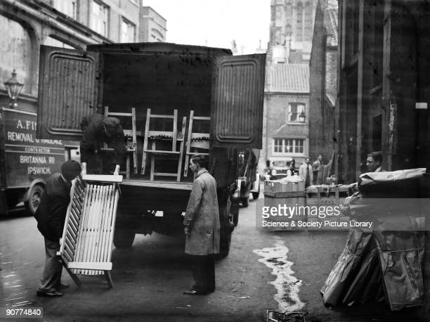 Furniture being loaded into a van at Camden goods yard London It was common to use the railways when moving house Furniture was loaded into a...