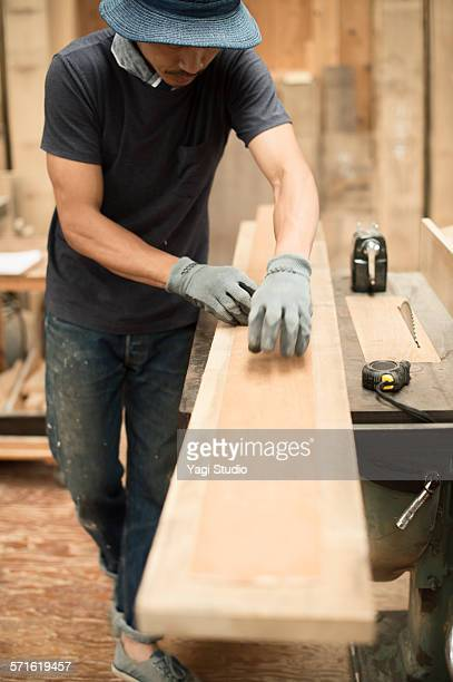 Furniture craftsman processing the wood