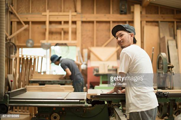 Furniture craftsman working in carpentry workshop