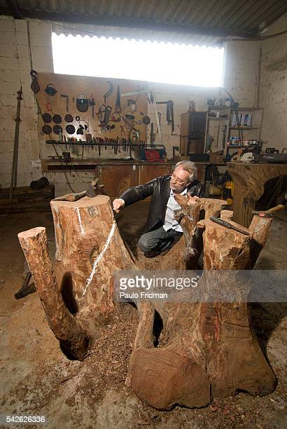 Furniture designer Hugo Franca marks out the final shape to one of his pieces made of old growth wood at his workshop in Louveira Brazil   Location...