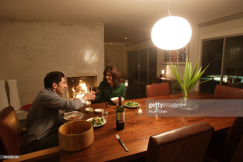 Furniture Designer Reza Feiz And Wife Sheila Griffiths Offer A Toast Over  Dinner In Their Home