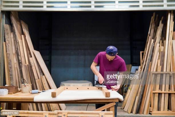 Furniture designer working in his workshop